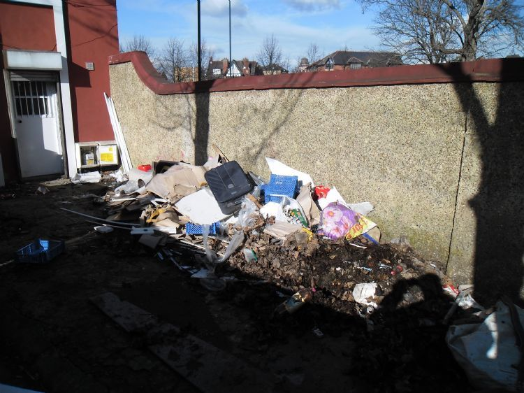 Clearance of dumped rubbish in garden